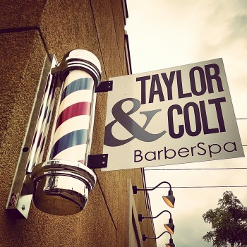Custom bracketed sign outside Taylor and Colt Barber Spa in Ann Arbor, MI